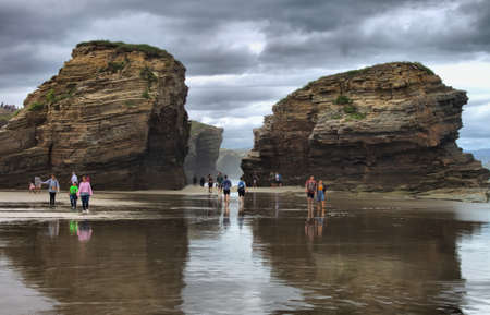 Galicia, Spain - August 16, 2018 : Tourists on the Beach of the Cathedrals in Galicia, Spain