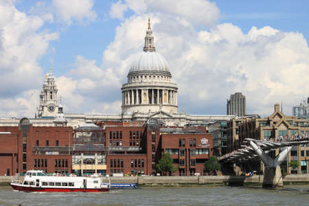 London, UK - August 7, 2014: London city skyline from the river Thames with Saint Paul Cathedral in the background