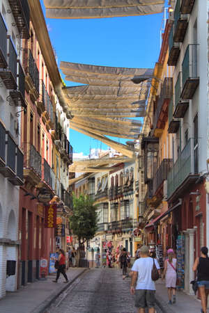 Sevilla, Spain - July 7, 2019: Cityscape of Sevilla with people walking in the downtown. Sevilla is one of the maor destinations of Spain