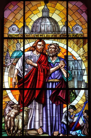 Stained glass window with Saint Peter and Jesus