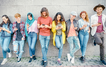 Group of fashion friends watching on their smart mobile phones - Millennial generation z addicted to new technology trends - Concept of people, tech, social media, friendship and youth lifestyle