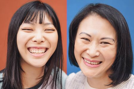 Happy Asian mother and daughter having fun outdoor - Portrait Chinese family people spending time together outside - Love, relationship and parenthood lifestyle concept 版權商用圖片
