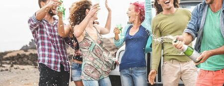 Group happy friends celebrating with champagne outdoor - Young people having fun drinking white wine during road trip vacation - Youth culture holidays lifestyle concept
