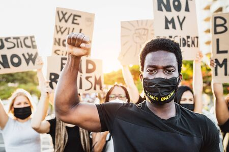 Black lives matter activist movement protesting against racism and fighting for equality - Demonstrators from different cultures and race protest on street for justice and equal rights