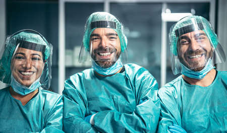 Surgeons smiling after a successful surgical operation - Medical workers the real heroes during corona virus outbreak - Doctor working for stop and preventing spread of coronavirus concept