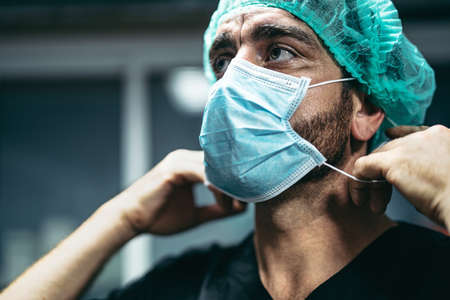 Surgeon preparing for surgical operation - Medical workers the real heroes during corona virus outbreak - Healthcare and doctor fighting and preventing spread of pandemic Reklamní fotografie