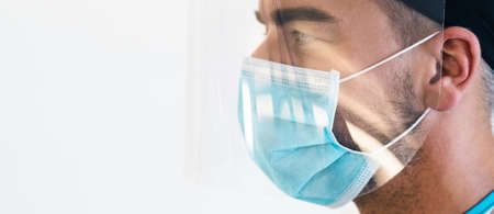Doctor wearing ppe face surgical mask and visor fighting against corona virus outbreak - Health care and medical workers concept Stock fotó