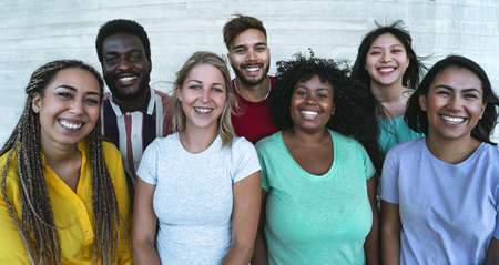 Group multiracial friends having fun outdoor - Young people from different culture and race - Diversity and youth millennial generation concept