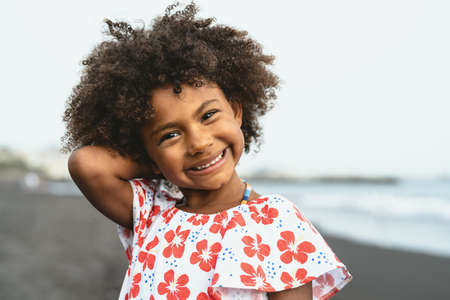Portrait of Afro American child having fun on the beach during vacation time