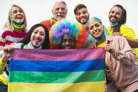 Happy Multiracial people celebrating pride festival during corona virus - Group of friends with different age and race fighting for gender equality