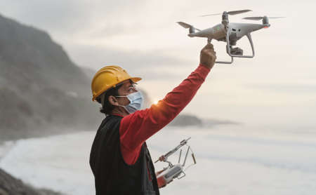 Male engineer doing inspection using drone - Technology and industrial concept