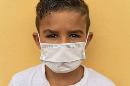 Child wearing face protective mask going back to school during corona virus pandemic - Safety covid19 measures concept
