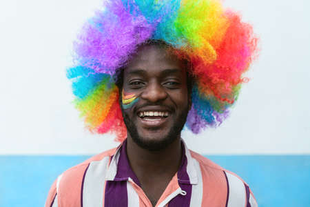 Happy African man having fun during gay pride festival day