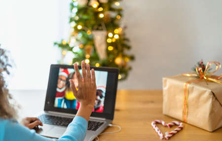 Happy African family having video call greetings during Christmas time - Social distancing and technology concept 写真素材