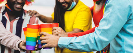 Happy multiracial people cheering and drinking cocktails in gay pride festival event during corona virus pandemic 写真素材