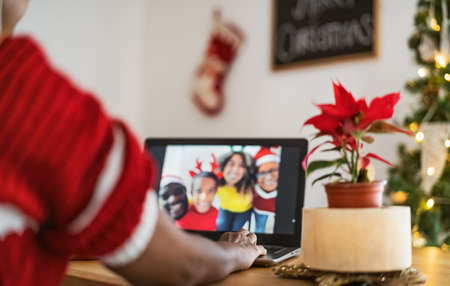 Happy African family having video call on computer during Christmas holidays 写真素材