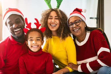 Happy African family having fun together celebrating Christmas holidays