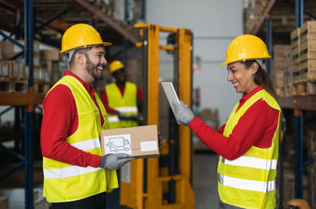 Team working in warehouse doing inventory using digital tablet and loading delivery boxes plan - Logistic and industry concept Standard-Bild