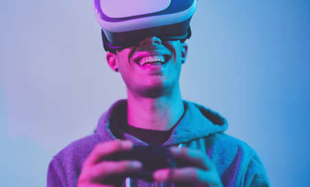 Young gamer playing to new video games with virtual reality experience - Youth people entertainment and technology concept