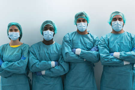 Team of medical workers wearing personal protective equipment against  virus outbreak - Doctor working for stop and preventing spread