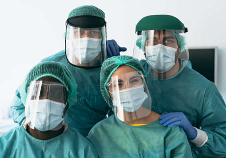 Doctors wearing personal protective equipment fighting against  virus outbreak - Health care and medical workers concept