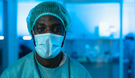 Portrait of doctor wearing protective face mask fighting against corona virus outbreak - Health care and medical worker concept
