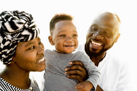 Happy African family having fun on the beach during summer holidays - Parents love concept 版權商用圖片