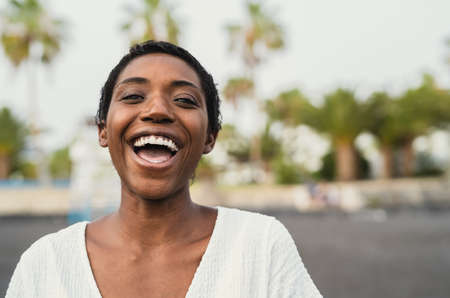 Happy African having fun during summer vacation on the beach
