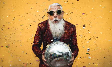 Crazy senior man having fun doing party during holidays time - Elderly people celebrating life concept 版權商用圖片