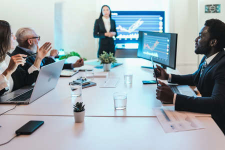 Business stock traders people in meeting room working on crypto currency markets with blockchain technology - Decentralized finance and stock exchange concept