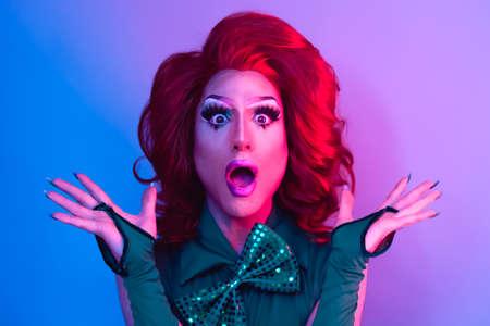 Happy drag queen having fun acting surprised in front of camera - LGBTQ concept