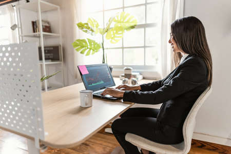 Business stock trader woman working on crypto currency markets at home - Decentralized finance and stock exchange concept