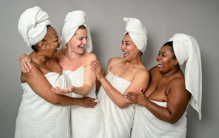 Happy multiracial females with different body size having skin care spa day - People selfcare concept