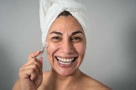 Happy Latin mature woman having skin care spa day - People wellness lifestyle concept 版權商用圖片