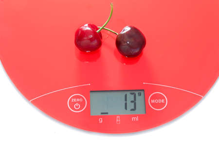 Cherries upon a digital scale photo