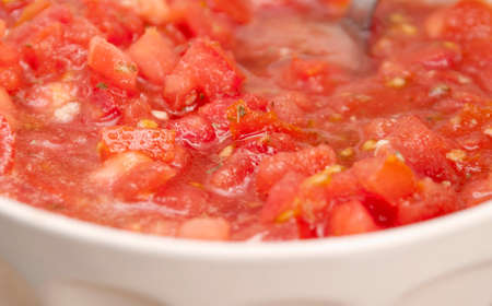dilute: Cut tomatos with oil, garlic, oregano, salt and pepper. Stock Photo