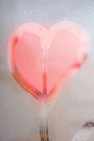 amore: Red heart with drops on the surface of a glass Stock Photo