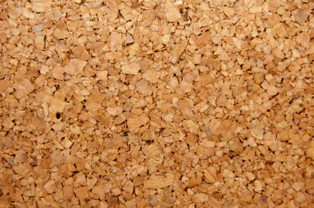 A detail photo of a brown cork board