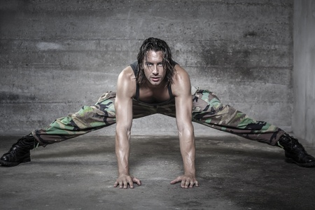 handsome muscle man stretches his muscle looking at camera  Stock Photo - 21640583
