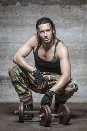handsome muscle man wearing camouflage pants photo