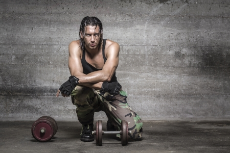 portrait of sweaty athlete resting from weight training photo
