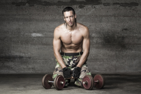 bare chest: portrait of an exhausted athlete resting from weight training Stock Photo