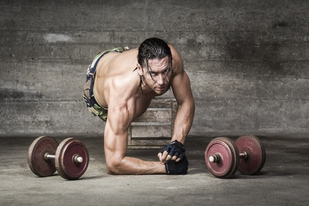 portrait of muscle athlete looking at camera with intense gaze photo