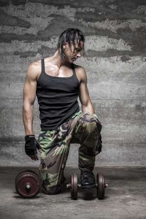 handsome muscular man looking down photo