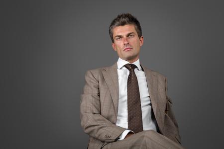 gray suit: Portrait of a classic elegant man with intense gaze