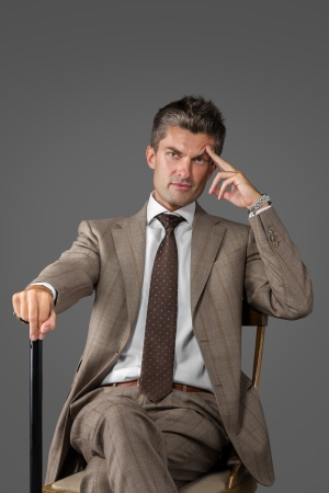 Portrait of a classic elegant man with walking stick photo