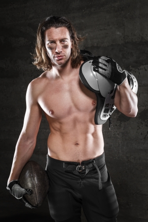 rugby player: Handsome muscular footballer Stock Photo