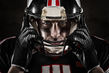 Portrait of american football player looking at camera with intense gaze
