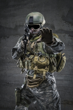 alt: Soldier with rifle and mask in alt gesture