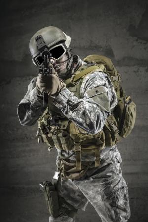 Soldier pointing gun at you